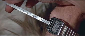 """James Bond's ticker-tape watch in """"The Spy Who Loved Me"""" prints out Dymo  label spray painted silver : Thatsabooklight"""